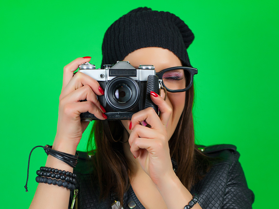 Photo of a photographer taken on a bright green screen